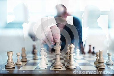 Business tactic with chess game and businessmen that work together in office. Concept of teamwork, partnership and