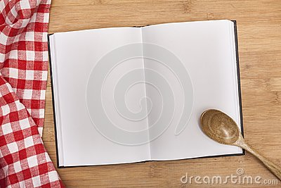 Empty notebook for recipes with spoon and