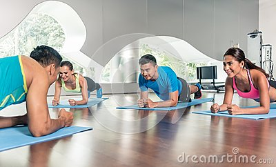 High-angle view of a fitness instructor during group calisthenics class