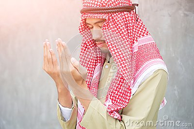 Muslim arabic man praying, prayer concept for faith, spirituality and religion.