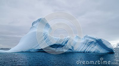 Iceberg drifting around Peterman Island in Antarctica.