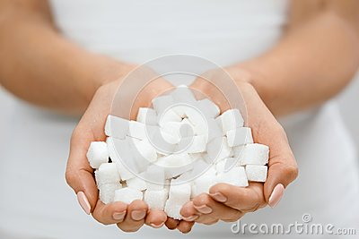 Female Hands With Sugar Cubes.