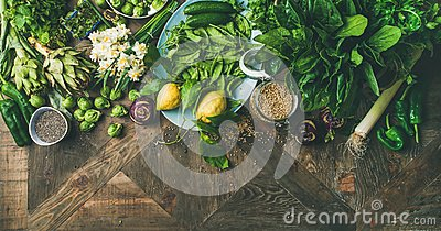 stock image of spring healthy vegan food cooking ingredients, wooden background, wide composition