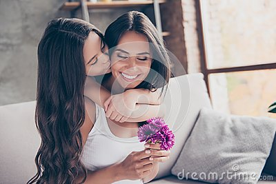 Concept of women`s day! Amazed cheerful joyful charming mum is h