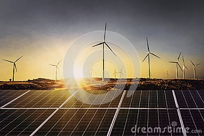 solar panels with wind turbine and sunset .concept power energy