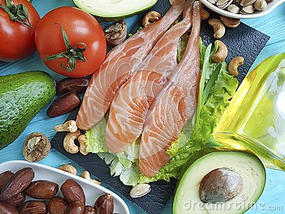 Fish salmon salad nourishment omega 3 avocado on blue wooden background healthy food