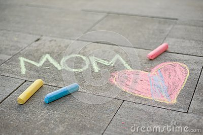 Happy Mother`s Day. Child draws for her mother a picture surprise of crayons on the asphalt. LOVE MOM