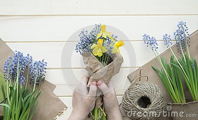 Children`s hands collect a bouquet as a gift. A gift for mom.