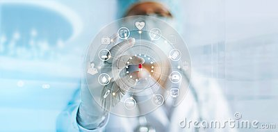 stock image of medicine doctor holding a color capsule pill in hand with icon medical network connection on modern virtual screen interface in la