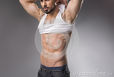 Muscle bound guy denuding his torso