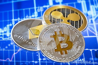 Cryptocurrency coins over trading graphic screen; Bitcoin, Ether
