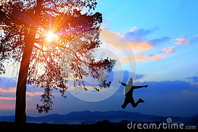 Freedom concept,silhouette women jumping happily in holiday,young teenagers recreation wiht adventure and camping