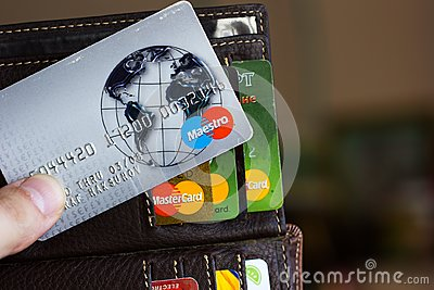 Ryazan, Russia - February 27, 2018: Credit card of Maestro brand over the leather wallet and number of cards.