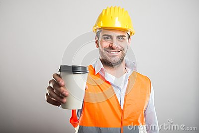 Portrait of architect offering takeaway coffee cup