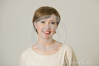 Portrait of young happy and pretty red hair woman on her 30s in sweet smile and positive face expression looking to camera isolate