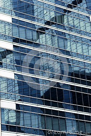 close up glass modern business office building and reflecion of