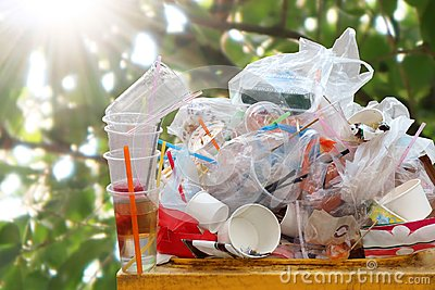 Garbage many close-up on Trash full of trash bin, Plastic bag waste Lots of junk on nature tree sunshine background