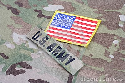 US ARMY branch tape with flag patch on camouflage uniform