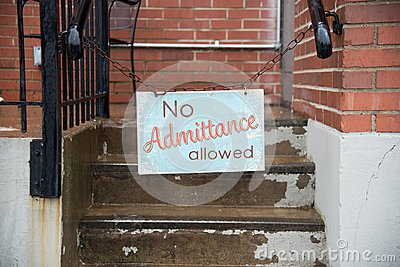 No admittance allowed sign hanging on chain in city