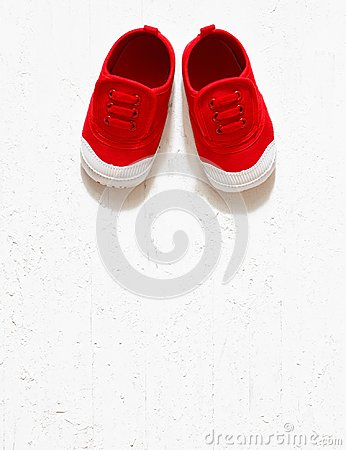 Children cute red small sized canvas shoes top view overhead s