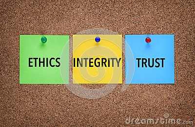 Three notes on corkboard with words Integrity, Trust, Ethics.