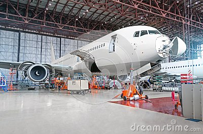 Passenger airplane on maintenance of engine and fuselage repair