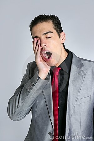 Businessman yawn boring on gray background