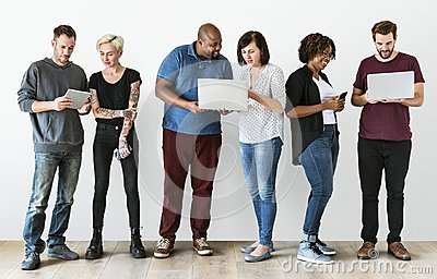 stock image of group of people using electronics device