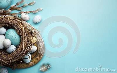 Easter background with Easter eggs and spring flowers on blue t