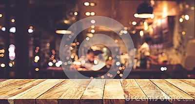 Wood table top Bar with blur night cafe background
