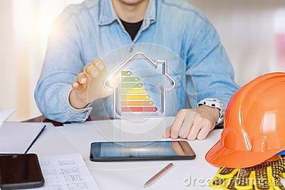 Engineer showing a model energy-efficient house .