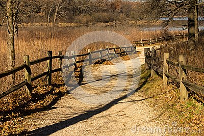 Split rail lined Gravel path at the Little Red Schoolhouse Nature Center