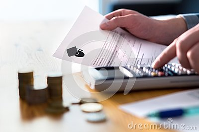 Man counting college savings fund, tuition fee or student loan.