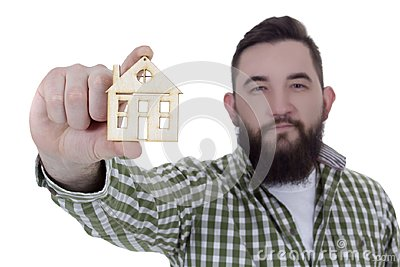 Young man with house model