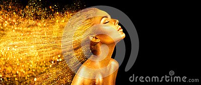 Fashion model woman in golden bright sparkles. Girl with golden skin and hair portrait closeup