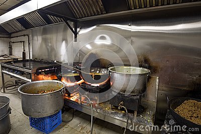 stock image of a real grungy dirty restaurant industrial & commercial kitchen e