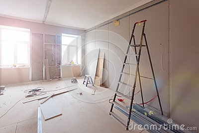 Interior of apartment during construction, remodeling, renovation, extension, restoration and reconstruction - ladde