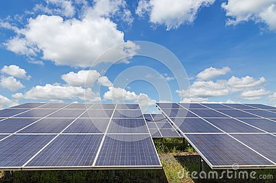 Close up rows array of polycrystalline silicon solar cells or photovoltaics in solar power plant turn up skyward absorb the sunlig