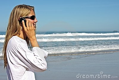Young blonde business woman making a phone call