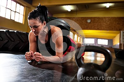 Workout at gym, doing hard intense training with weight