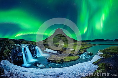 Northern Light, Aurora borealis at Kirkjufell in Iceland. Kirkjufell mountains in winter