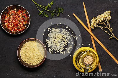 Japanese rice in a wooden bowl. Wooden chopsticks On the table of a bamboo mat. Asian cuisine. View from above.