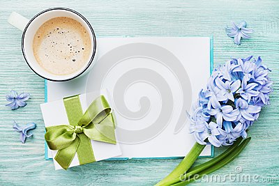 Mothers Day spring holiday card with empty notebook for greeting text with cup of coffee, gift or present box and hyacinth flowers