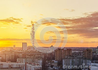 stock image of environmental problem of environmental pollution and air in large cities. sunny sunset. air pollution. the city from above