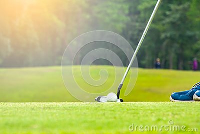 Golfer putting golf ball to hole for the winner