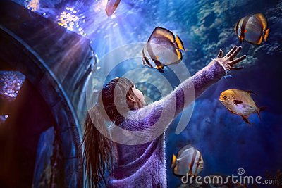Little girl in the Aquarium