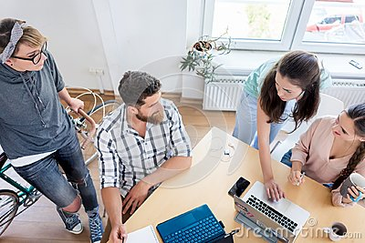 Young co-workers cooperating while working as freelancers