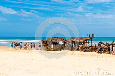 People at the Maheno shipwreck on 75 mile beach, one of the most popular landmarks on Fraser Island, Fraser Coast, Queensland, Aus