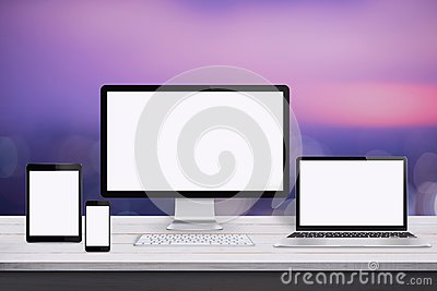 Responsive web design mockup. Devices with screen on white wooden desk