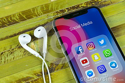 Apple iPhone X with icons of social media facebook, instagram, twitter, snapchat application on screen. Social media icons. Social